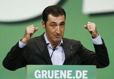 Cem Oezdemir of the environmental Greens party (Die Gruenen) makes a point during his speech at a party meeting in Berlin October 19, 2013. REUTERS/Tobias Schwarz