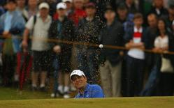 Francesco Molinari of Italy watches his shot from a bunker on the sixth hole during the third round of the British Open Championship at the Royal Liverpool Golf Club in Hoylake, northern England July 19, 2014.  REUTERS/Cathal McNaughton