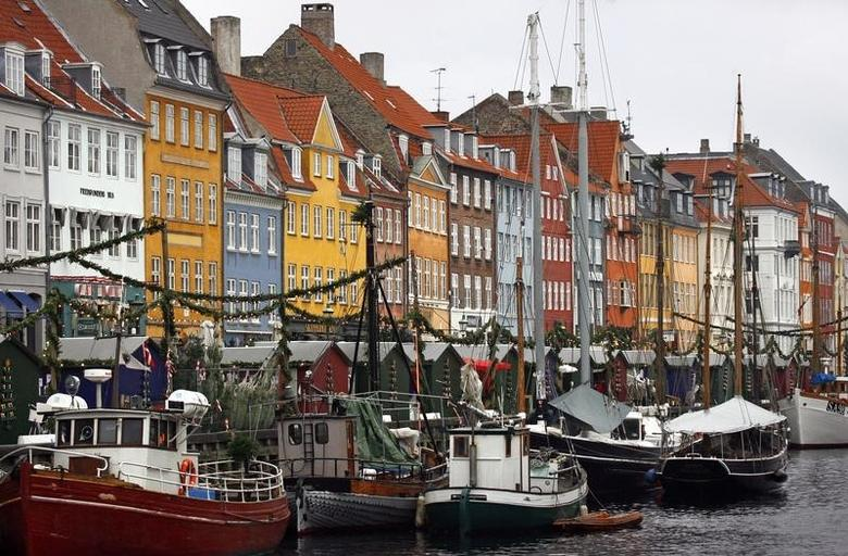 Boats are seen anchored at the 17th century Nyhavn district, home to many shops and restaurants in Copenhagen December 5, 2009. REUTERS/Bob Strong