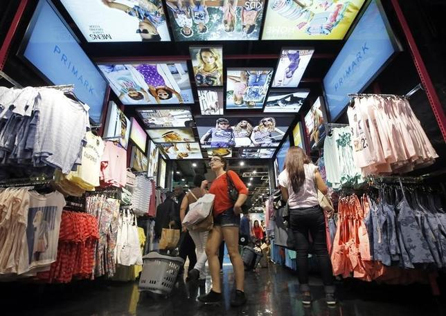 Customers shop at a Primark store on Oxford Street in London June 20, 2014.  REUTERS/Luke MacGregor