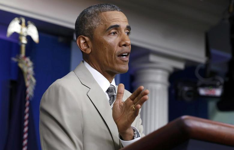 U.S. President Barack Obama answers questions in the White House Press Briefing Room ahead of a meeting with his national security council in Washington, August 28, 2014. REUTERS/Larry Downing