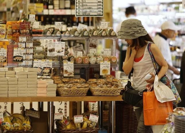 A woman looks at food products at a supermarket at a shopping district in Tokyo July 29, 2014. REUTERS/Yuya Shino
