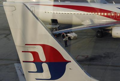 Tragedy-hit Malaysia Airlines to lose 6,000 jobs in...