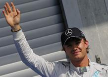 Mercedes Formula One driver Nico Rosberg of Germany celebrates his pole position after qualifying session at the Belgian F1 Grand Prix in Spa-Francorchamps August 23, 2014. REUTERS/Yves Herman