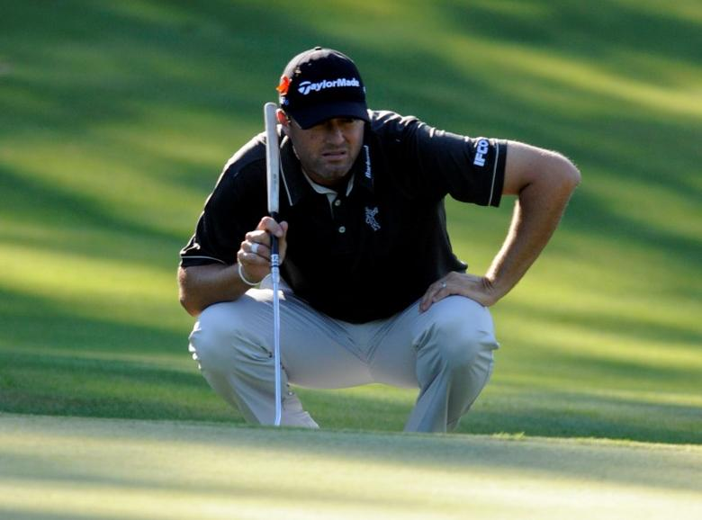 Aug 29, 2014; Norton, MA, USA; Ryan Palmer lines up his putt on the 6th hole during the first round of the Deutsche Bank Championship golf tournament at TPC of Boston. Mandatory Credit: Mark Konezny-USA TODAY Sports