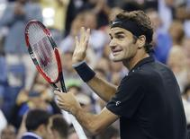 Roger Federer of Switzerland celebrates defeating Sam Groth of Australia in their men's singles match at the 2014 U.S. Open tennis tournament in New York, August 29, 2014.   REUTERS/Shannon Stapleton
