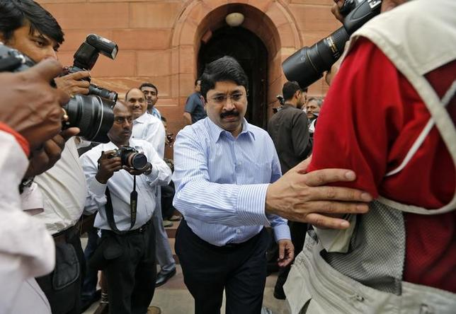 Dayanidhi Maran (C), a leader of Dravida Munnetra Kazhagam (DMK) party, walks after attending the parliament session in New Delhi March 20, 2013. REUTERS/Adnan Abidi/Files