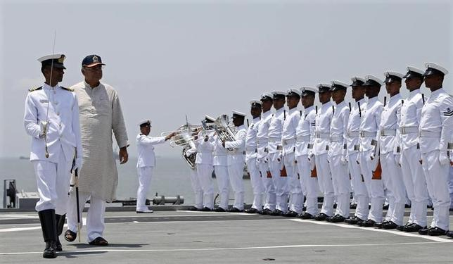 Finance Minister and Defence Minister Arun Jaitley (2nd L) inspects a guard of honour aboard aircraft carrier ''INS Viraat'', in Mumbai June 7, 2014. REUTERS/Stringer/Files