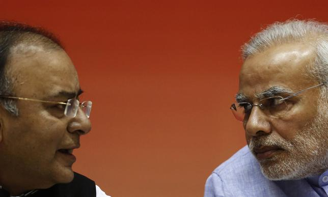 Prime Minister Narendra Modi speaks with India's Finance Minister Arun Jaitley (L) during the launch of the Jan Dhan Yojana, or the Scheme for People's Wealth, in New Delhi August 28, 2014. REUTERS/Adnan Abidi