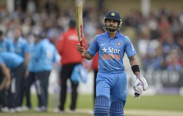 India's Virat Kohli leaves the field after being dismissed during the third one-day international cricket match against England at Trent Bridge cricket ground, Nottingham, England  August 30, 2014.  REUTERS/Philip Brown