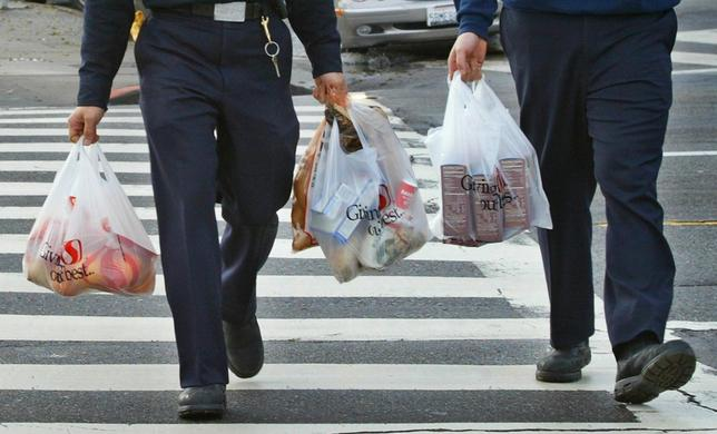 Firemen carry plastic grocery bags as they return to their station in San Francisco, California, in this file photo taken January 26, 2005.  REUTERS/Kimberly White