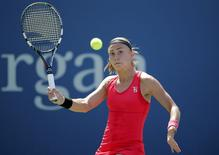 Aleksandra Krunic of Serbia hits a return to Petra Kvitova of the Czech Republic during their match at the 2014 U.S. Open tennis tournament in New York, August 30, 2014.  REUTERS/Eduardo Munoz
