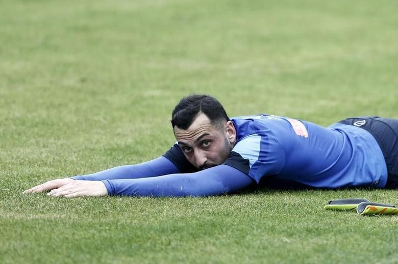 Greece's Kostas Mitroglou stretches during a training session in Athens May 19, 2014. Greece's coach Fernando Santos named his World Cup squad of 23 players on Monday. REUTERS/Yorgos Karahalis