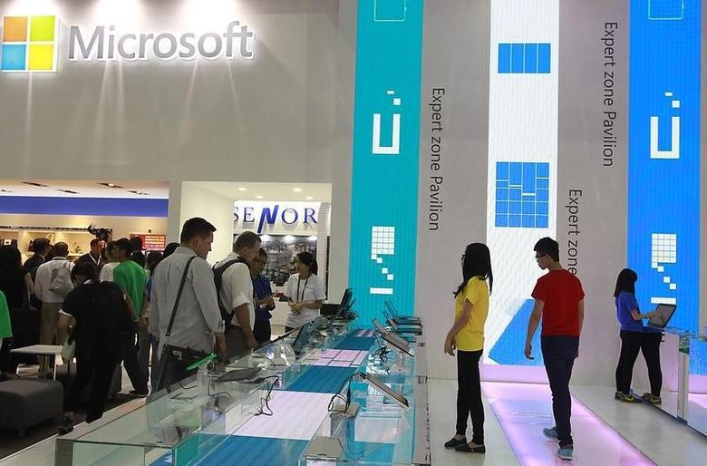 People visit the Microsoft booth during the 2014 Computex exhibition at the TWTC Nangang exhibition hall in Taipei June 3, 2014. REUTERS/Pichi Chuang