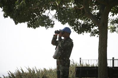 Syrian army, rebels fight on Golan where peacekeepers...
