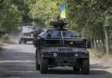 Veículo blindado das Forças Armadas da Ucrânia em Kramatorsk. 1/09/2014.  REUTERS/Gleb Garanich