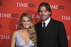 Honoree and singer Carrie Underwood arrives with her husband Mike Fisher at the Time 100 gala celebrating the magazine's naming of the 100 most influential people in the world for the past year, in New York April 29, 2014. REUTERS/Lucas Jackson