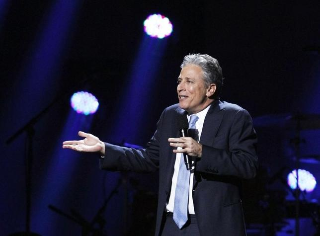 Comedian Jon Stewart speaks during the ''12-12-12'' benefit concert for victims of Superstorm Sandy at Madison Square Garden in New York in this file photo from December 12, 2012. ''The Daily Show'' host, and now film director brings his first film, ''Rosewater'' to the Toronto International Film Festival this week.   REUTERS/Lucas Jackson/Files