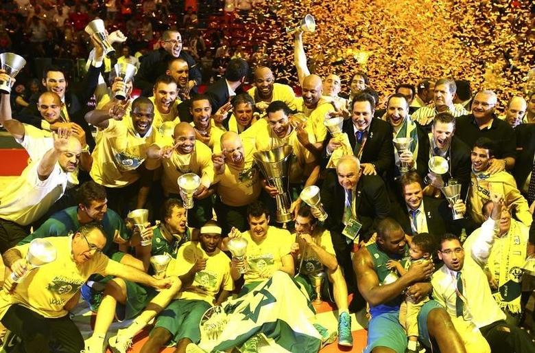 Maccabi Electra Tel Aviv players celebrate after winning the Euroleague Final Four final basketball game against Real Madrid, in Milan May 18, 2014. REUTERS/Giuseppe Cottini
