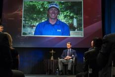 Ryder Cup team U.S. captain Tom Watson smiles as he announces that Hunter Mahan (on screen) will be one of his three picks to add to this year's Ryder Cup squad during an event in New York September 2, 2014.REUTERS/Lucas Jackson