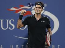 Roger Federer of Switzerland celebrates defeating Roberto Bautista Agut of Spain in men's singles play following their match at the 2014 U.S. Open tennis tournament in New York, September 2, 2014.   REUTERS/Shannon Stapleton