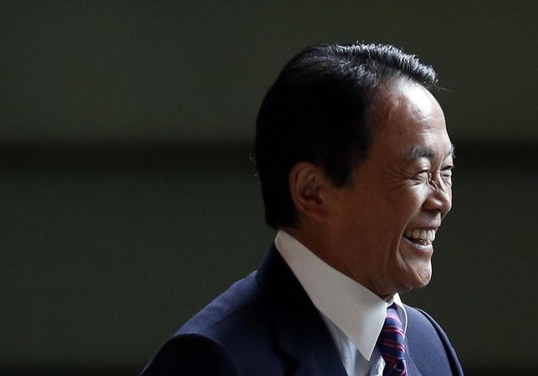 Japan's Deputy Prime Minister and Finance Minister Taro Aso smiles as he arrives at Prime Minister Shinzo Abe's official residence in Tokyo September 3, 2014. REUTERS/Yuya Shino