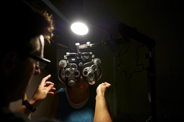 A patient undergoing an eye examination at a clinic in Wise, Virginia July 20, 2012. REUTERS/Mark Makela