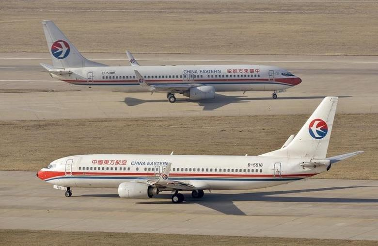 China Eastern Airlines Boeing 737-800 planes are seen at an airport in Taiyuan, Shanxi province, April 6, 2014.  REUTERS/Jon Woo