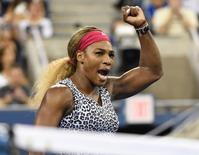 Sep 3, 2014; New York, NY, USA; Serena Williams (USA) celebrates after recording match point against Flavia Pennetta (ITA) on day ten of the 2014 U.S. Open tennis tournament at USTA Billie Jean King National Tennis Center. Mandatory Credit: Robert Deutsch-USA TODAY Sports