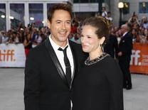 "Cast member and executive producer Robert Downey Jr. (L) and his wife, producer Susan Downey pose as they arrive at the gala for the film ""The Judge"" at the Toronto International Film Festival (TIFF) in Toronto, September 4, 2014. REUTERS/Mark Blinch"