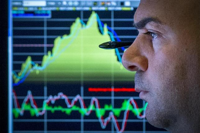 A trader watches his screen on the floor of the New York Stock Exchange August 12, 2014. REUTERS/Brendan McDermid