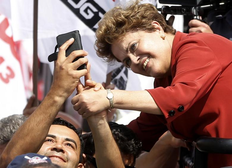 Brazil's President and Workers Party (PT) presidential candidate Dilma Rousseff  (R) poses for a selfie with a supporter during a campaign rally in Sao Bernardo do Campo September 2, 2014. REUTERS/Paulo Whitaker