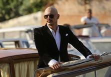 Director James Franco stands in a boat as he is filmed at the 71st Venice Film Festival September 5, 2014. REUTERS/Manuel Silvestri