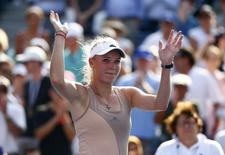 Caroline Wozniacki of Denmark celebrates after winning her semi-final match against Peng Shuai of China after Shuai had to retire due to an injury at the 2014 U.S. Open tennis tournament in New York, September 5, 2014.         REUTERS/Adam Hunger