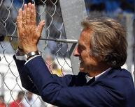 Ferrari President Luca Cordero di Montezemolo waves to the supporters from the pit wall during the third practice session of the Italian F1 Grand Prix in Monza September 6, 2014. REUTERS/Stefano Rellandini