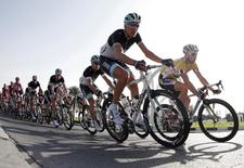 HTC Highroad team rider Mark Renshaw (R) of Australia leads the pack of riders cycling during the 5th stage of the 10th Tour of Qatar cycling race Sealine Beach Resort to Doha, February 11, 2011. REUTERS/Jacky Naegelen