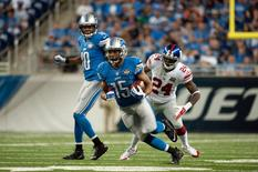 Sep 8, 2014; Detroit, MI, USA; Detroit Lions wide receiver Golden Tate (15) runs the ball during the fourth quarter against the New York Giants at Ford Field. Detroit won 35-14. Mandatory Credit: Tim Fuller-USA TODAY Sports