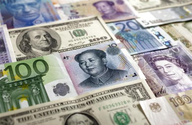Arrangement of various world currencies including Chinese Yuan, Japanese Yen, US Dollar, Euro, British Pound, Swiss Franc and Russian Rouble pictured in Warsaw, January 26, 2011.   REUTERS/Kacper Pempel