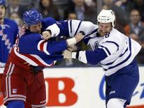Toronto Maple Leafs forward Colton Orr fights New York Rangers forward Derek Boogaard (L) during the first period of their NHL hockey game in Toronto October 21, 2010.     REUTERS/Mike Cassese