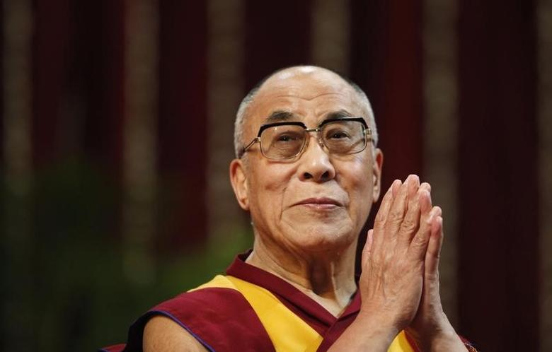 The Dalai Lama gestures before speaking to students during a talk at Mumbai University February 18, 2011. REUTERS/Danish Siddiqui