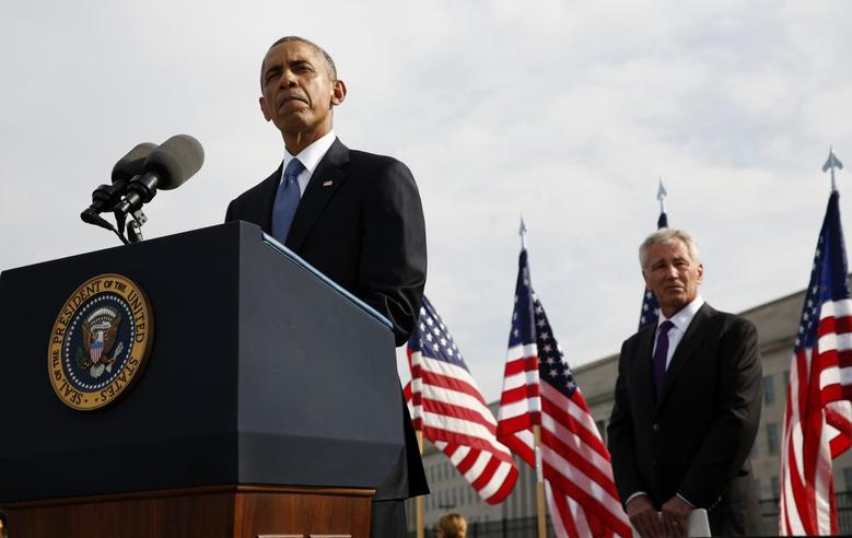 U.S. President Barack Obama speaks during a ceremony marking the 13th anniversary of the 9/11 attacks at the Pentagon in Washington September 11, 2014. REUTERS/Kevin Lamarque