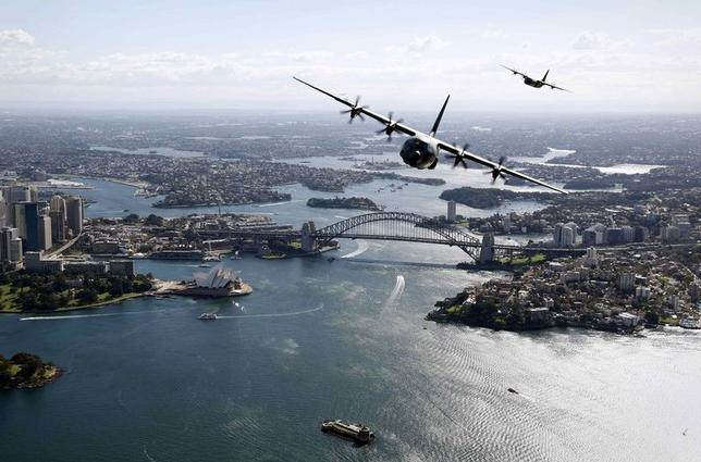 Two Royal Australian Air Force (RAAF) C-130J Hercules aircraft fly above the Sydney Opera House and Sydney Harbour Bridge during a display, in this handout picture released by the Australian Defence Force September 10, 2014. REUTERS/Australian Defence Force/Handout via Reuters