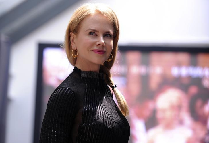 Actress Nicole Kidman smiles as she attends a news conference to promote her new film ''Grace of Monaco'' during the 17th Shanghai International Film Festival, in Shanghai, June 15, 2014. REUTERS/Stringer/Files