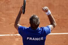 French tennis player Richard Gasquet celebrates after defeating Czech Republic's Tomas Berdych in the opening match of their Davis Cup semi-final at Roland Garros Stadium in Paris September 12, 2014. REUTERS/Charles Platiau
