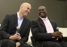 Shaquille O'Neal (R) jokes with former Cleveland Cavaliers general manager Danny Ferry during a news conference at the Cavaliers' practice facility in Independence, Ohio in this July 2, 2009, file photo.REUTERS/Aaron Josefczyk/Files