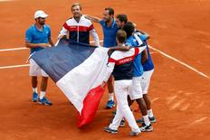 (From L, visible faces) French team captain Arnaud Clement, Julien Benneteau, Michael Llodra and Gilles Simon react after their victory over Czech Republic in the semi-final of the Davis Cup at the Roland Garros stadium in Paris September 14, 2014. REUTERS/Charles Platiau