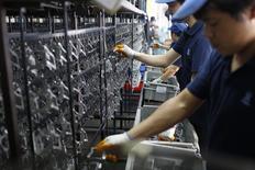 La production industrielle chinoise a augmenté en août de 6,9% à son rythme le plus faible depuis près de six ans et la croissance a aussi ralenti dans d'autres secteurs de l'économie, selon des données officielles publiées samedi. /Photo prise le 8 juillet 2014/REUTERS/Aly Song