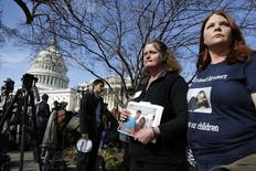 Family members of victims of the GM recall failure arrive to hold a news conference on the U.S. Capitol grounds in Washington April 1, 2014. REUTERS/Jonathan Ernst