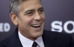 "Cast member George Clooney arrives for the premiere of his movie ""The Monuments Men"" in New York February 4, 2014. REUTERS/Carlo Allegri"