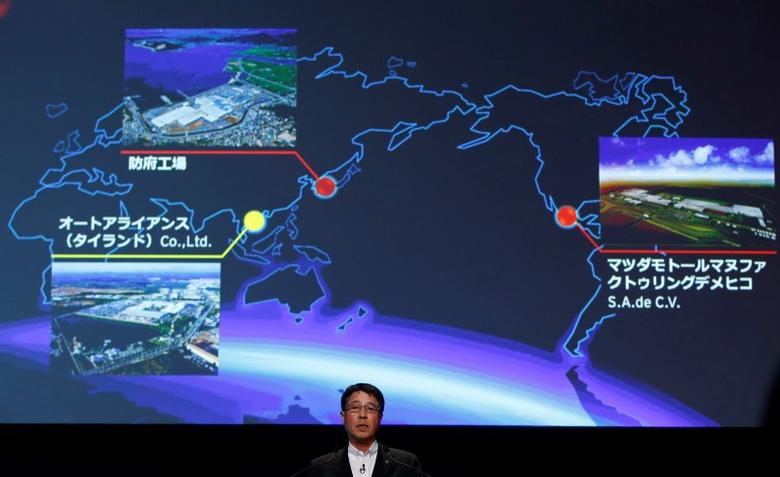 Mazda Motor Corp Chief Executive Masamichi Kogai speaks during a news conference in Tokyo in this September 11, 2014 file photo.  REUTERS/Toru Hanai